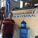 Rob in front of festival sign
